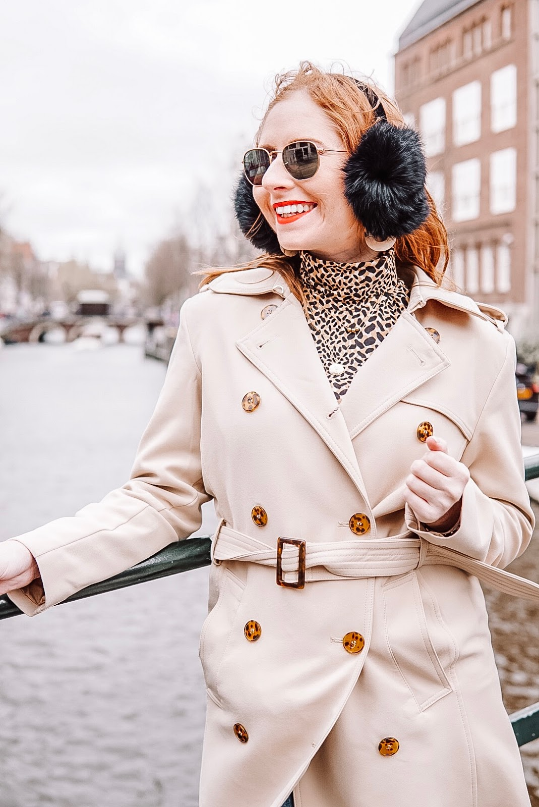 amanda burrows is a tampa blogger traveling to amsterdam in the spring. she is wearing a tan trench coat from h&m.