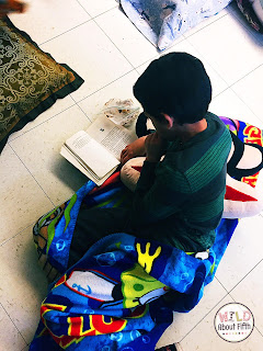 A student reads intently during a classroom read-in.