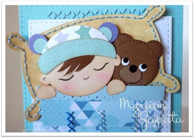 Tarjeta bebé cosida. Detalle de costura en almohadón y cabecero