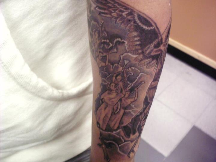 Justin Graves Tattoo: Angel Fighting A Demon Sleeve