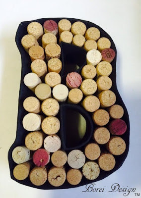 How to make a monogram wine cork holder using recycled materials.