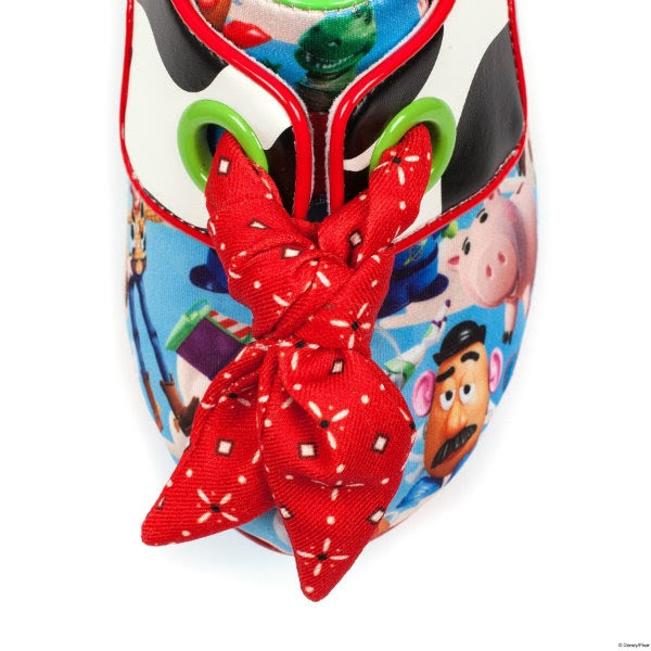 close up of toy story character print toe of shoe with red bandana lace and green eyelets on white background