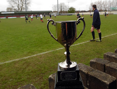 Picture: The Adrian Gibbons 2018 memorial football match under way at Brigg Town FC's Hawthorns ground. The teams were playing for this trophy, remembering the renowned local teacher and footballer. This game is now an established annual event - see Nigel Fisher's Brigg Blog