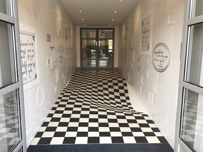 Genius Optical Illusion On The Floor Prevents People From Running In The Hallway