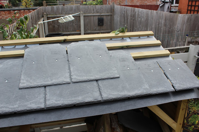 DIY slate roofing log store