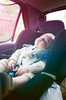 child asleep in the back of the car