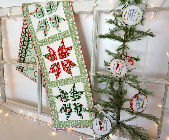 Joyful Snowflake table runner is sewn using Comfort and Joy fabric from Riley Blake
