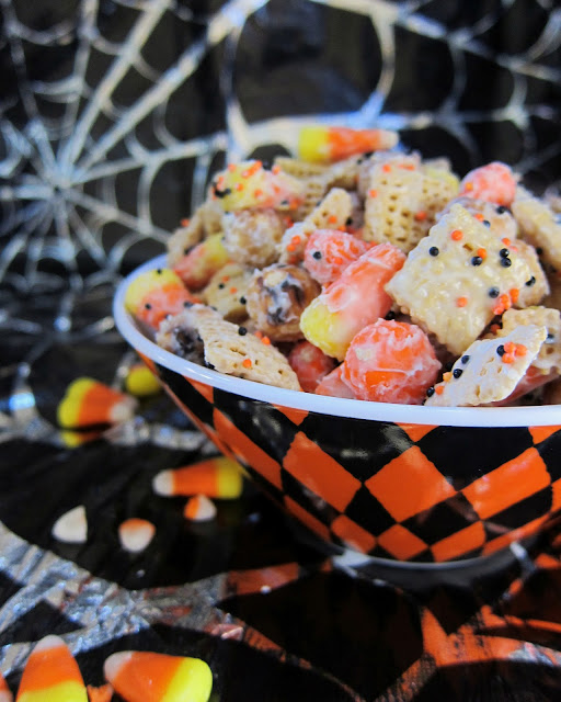 Halloween Chex Mix - chocolate coated chex mix with candy corn, pretzels and chocolate. Sweet & Salty! Takes minutes to make. Great for class party treats!
