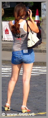 Girl in denim shorts on the street