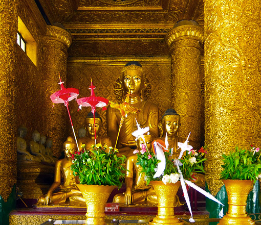 gold Buddha and flower donations