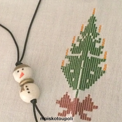 a wooden snowman necklace
