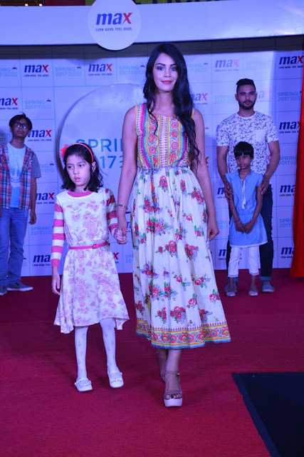 Models walking the ramp with the kids