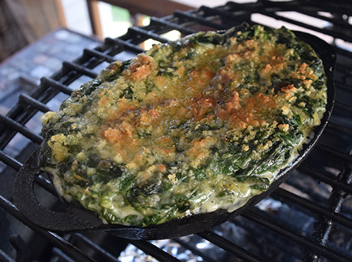 Spinach Maria cooked in a cast iron dish on the grill