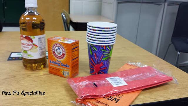 photo of supplies- apple cider, baking soda, paper cups, tissue paper