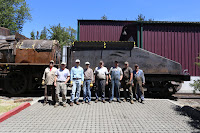 Tender tank project volunteers and staff pose with the new tank on the tender frame.
