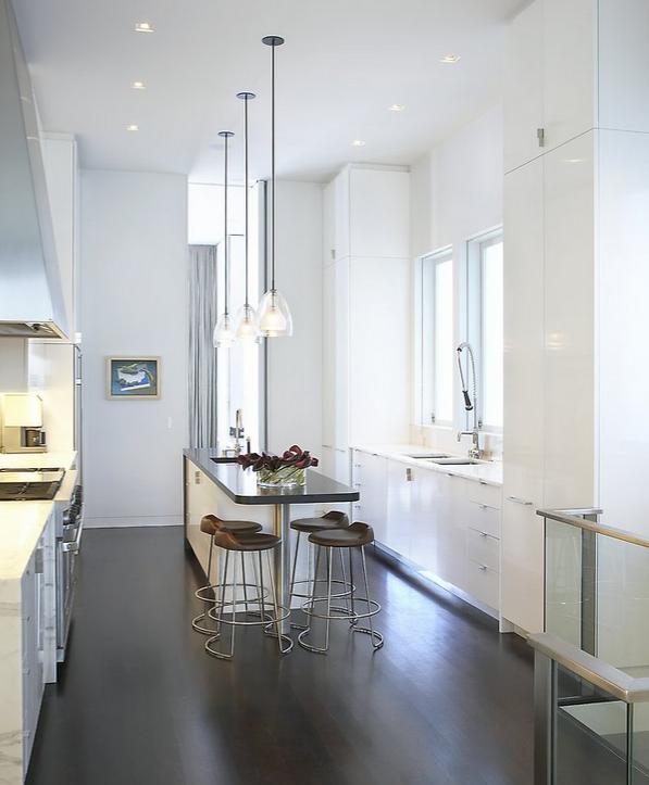 A Modern Kitchen Fits This Loft Below