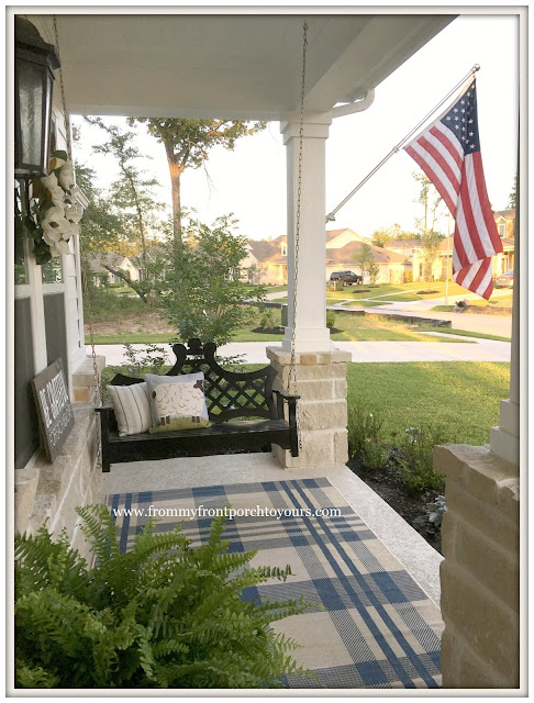 Suburban Farmhouse Front Porch-Porch Swing-Plaid Outdoor Rug-American Flag-From My Front Porch To Yours