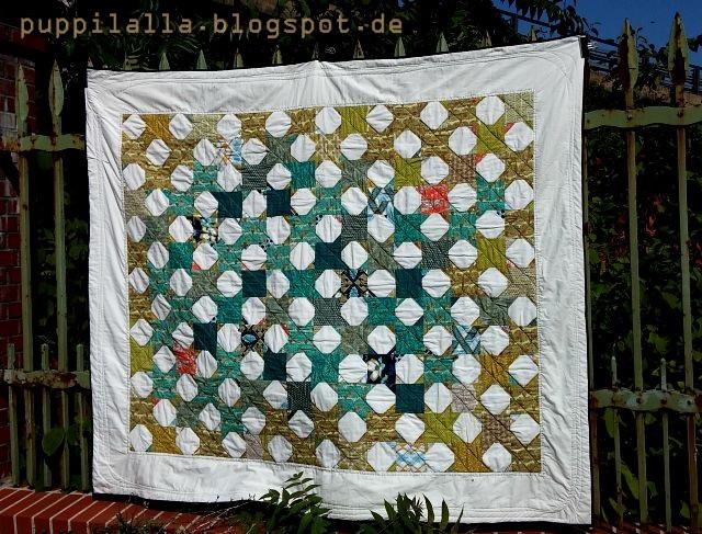 Snowball block quilt Puppilalla Design green blue