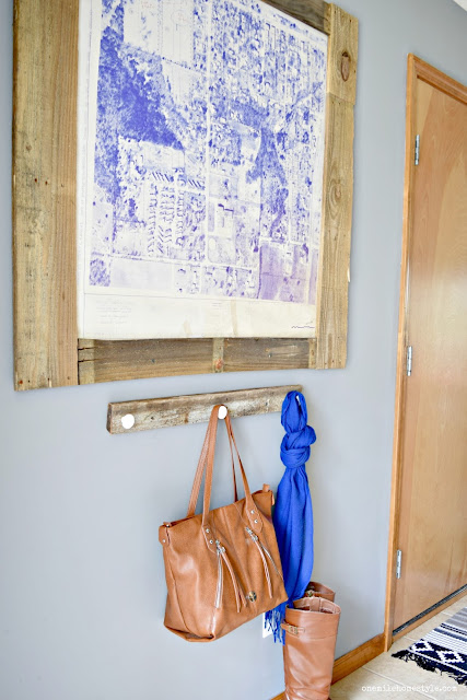 Large scale maps add a fun personalized touch to you home, and add a simple DIY pallet wood frame for that perfect rustic accent.