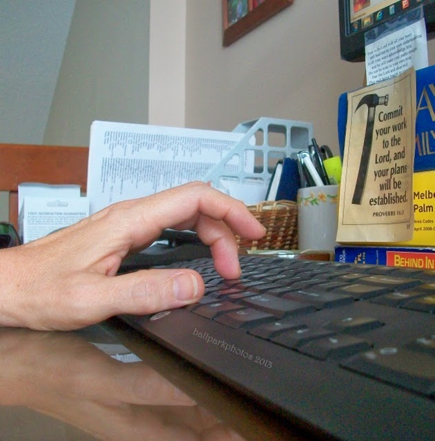 Writing fingers at the keyboard