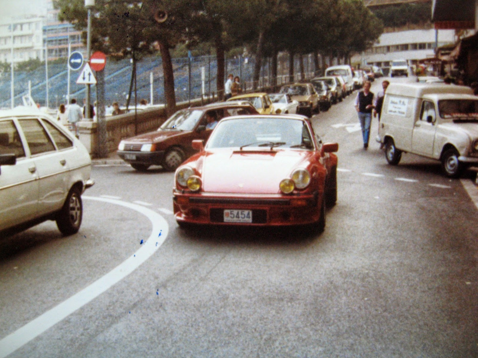 Tommy Mondello & Billy Scire watching cars at outdoor cafe Monaco 1983