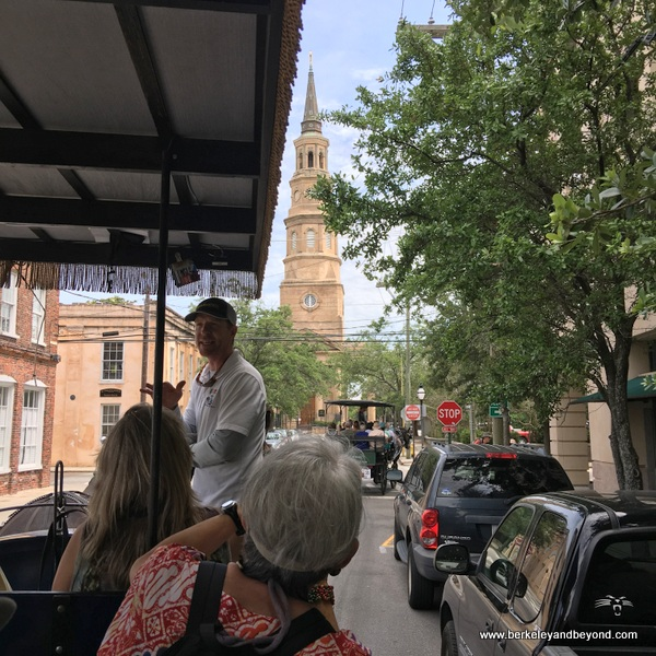 horse-drawn carriage tour of Charleston, South Carolina, with view of leaning St. Philip's Church