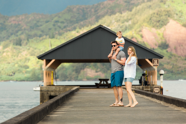 Family photo on the Hanalei Bay pier in Kauai