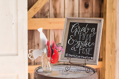 Rustic barn wedding meets vintage fairy tale. Meadow Creek Farm North Alabama Wedding Venue. Vintage Beauty and the Beast inspired wedding reception decoration ideas. Wedding photo prop booth sign. Grab a prop and strike a pose