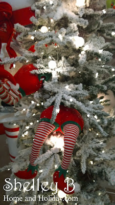 its called elf butts and thats exactly what they look like posable legs allow you to place this whimscal decoration in a christmas tree - Elf Legs Christmas Decoration