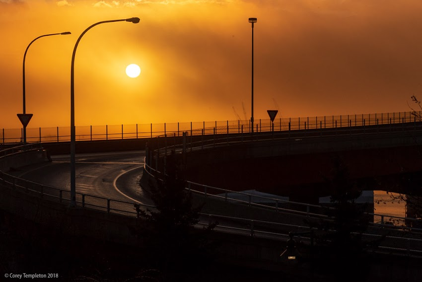 Portland, Maine USA December 2018 photo by Corey Templeton. An ominous sun rising through the fog this morning, above the Casco Bay Bridge.
