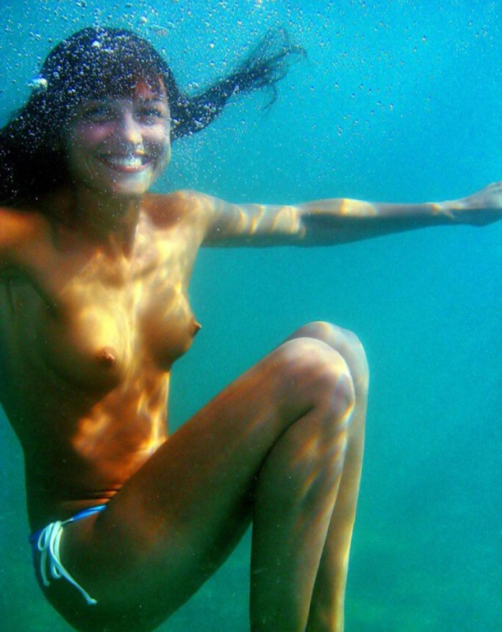 underwater naked swimming