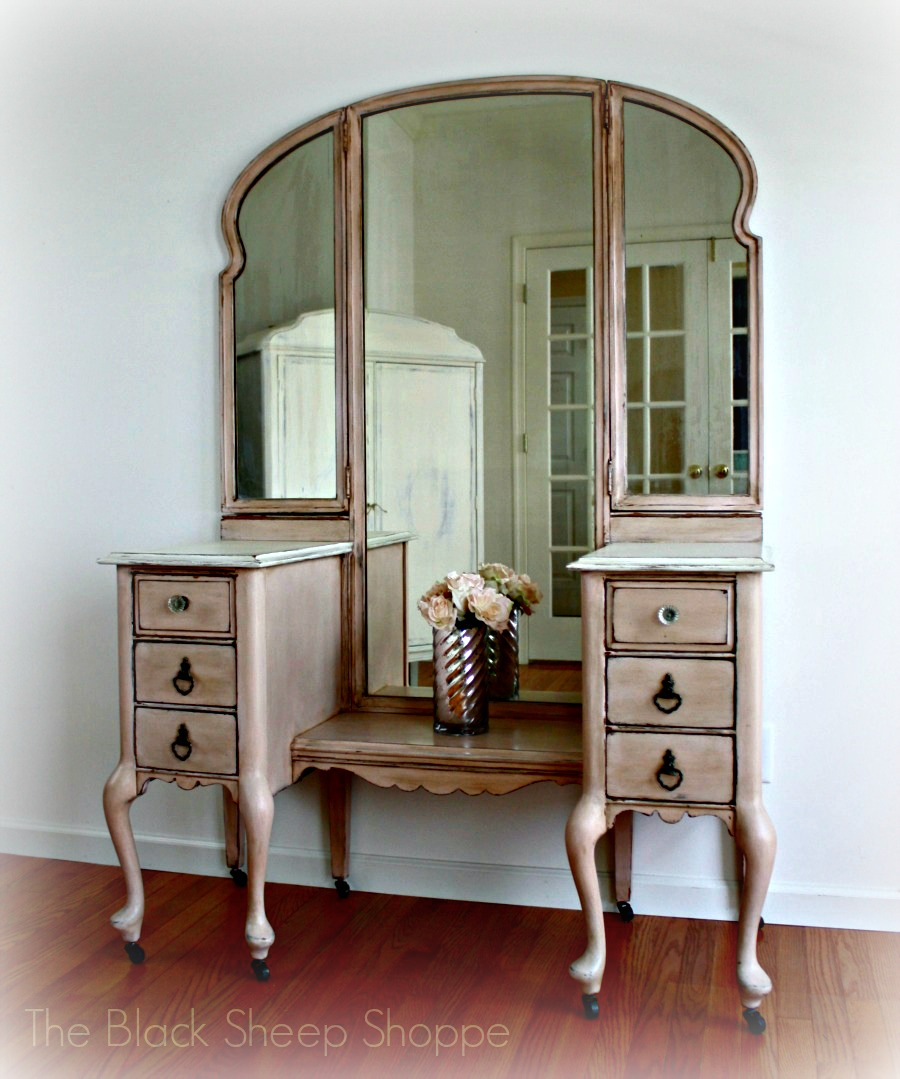Painted vanity with tri-fold mirrors by The Black Sheep Shoppe