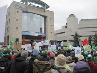 Crowds gather in front of Ottawa City Hall.