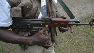 Man Shot for Picking Stolen Money as Armed Robbers Flee