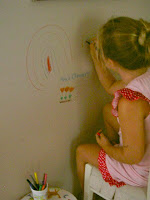 kids helping paint walls
