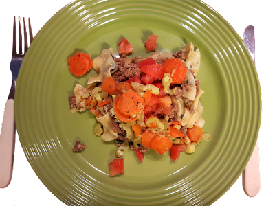 A green dinner plate with a serving of a ground turkey and vegetable dish/recipe.