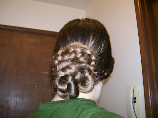 Back chignon with braids wrapped around.