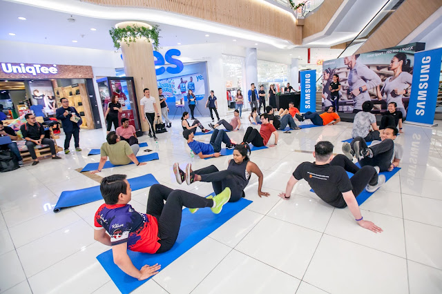 Participants in a team workout during the High Intensity Interval Training (HIIT) at Lot 10.