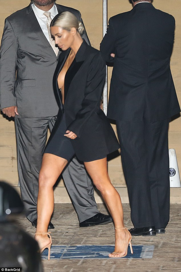 Kim Kardashian flashes her sideboob in oversized tuxedo as she steps out for celebratory dinner
