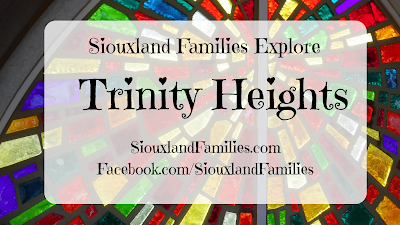 "In background, jewel toned stained glass in a geometric starburst pattern from the shrine to Our Lady of Guadalupe at Trinity Heights in Sioux City, Iowa. In foreground, the words "" Siouxland Families Explore Trinity Heights"""