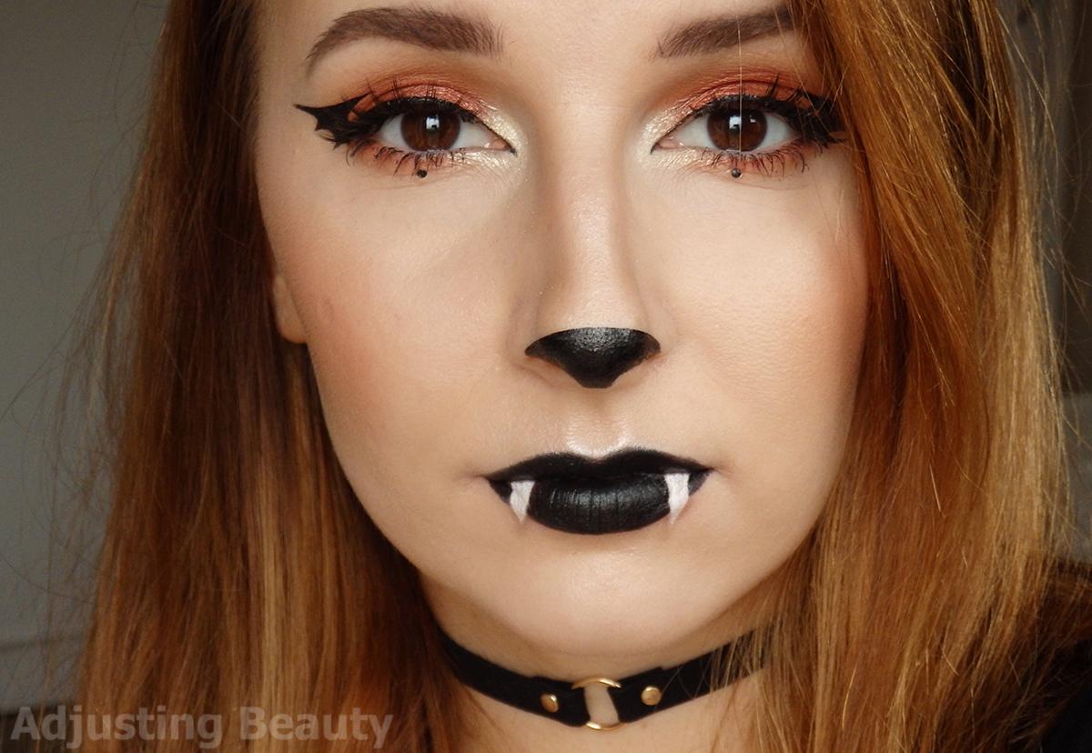 cute bat halloween makeup adjusting beauty