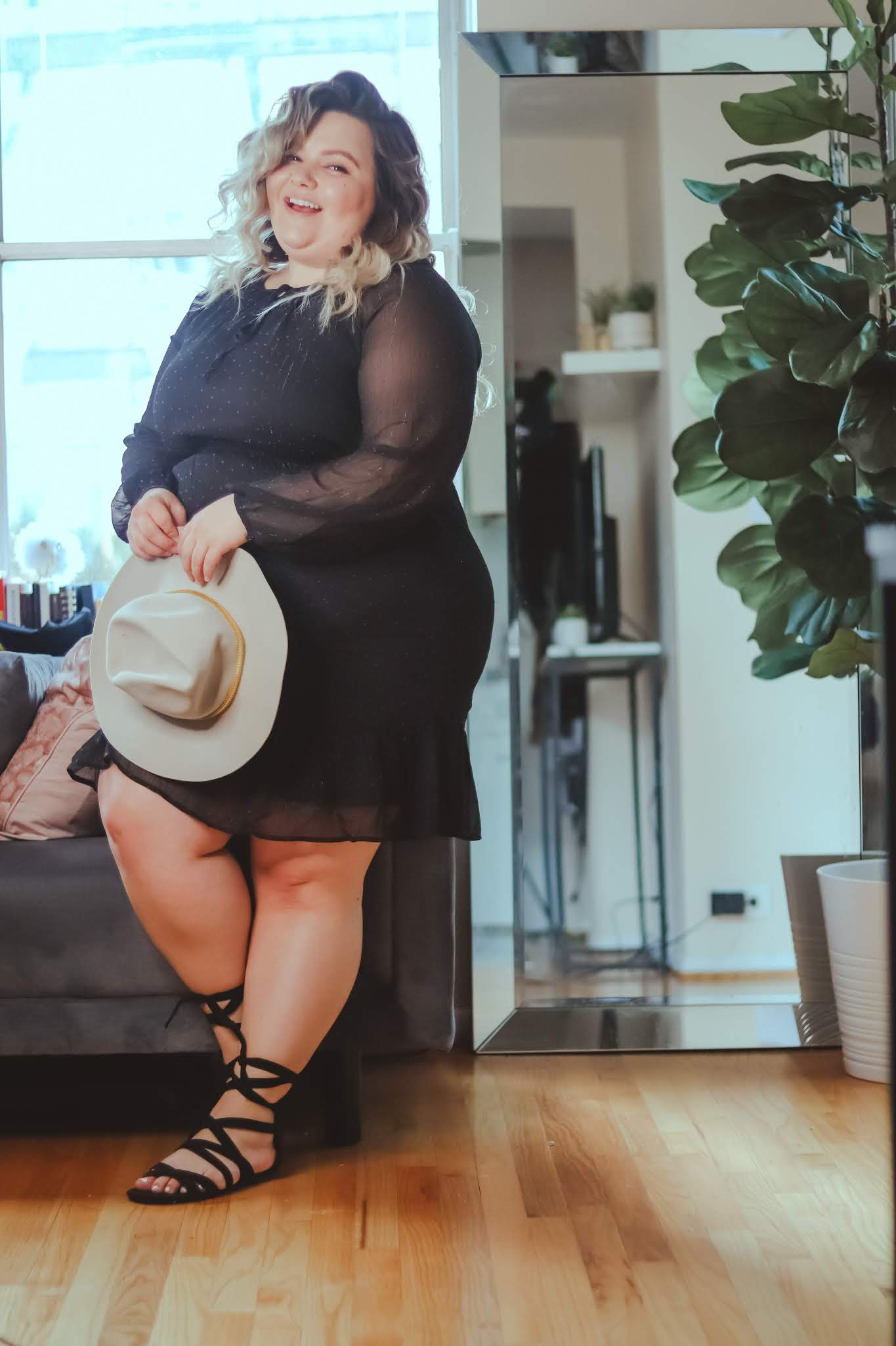 Chicago Plus Size Petite Fashion Blogger, influencer, YouTuber, and model Natalie Craig, of Natalie in the City, reviews Common Assembly's ruffle mini dress and addresses confidence and self esteem during COVID-19.