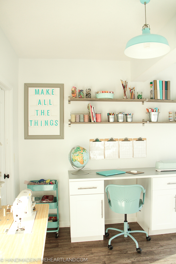 beautiful inspiring white and aqua craft space