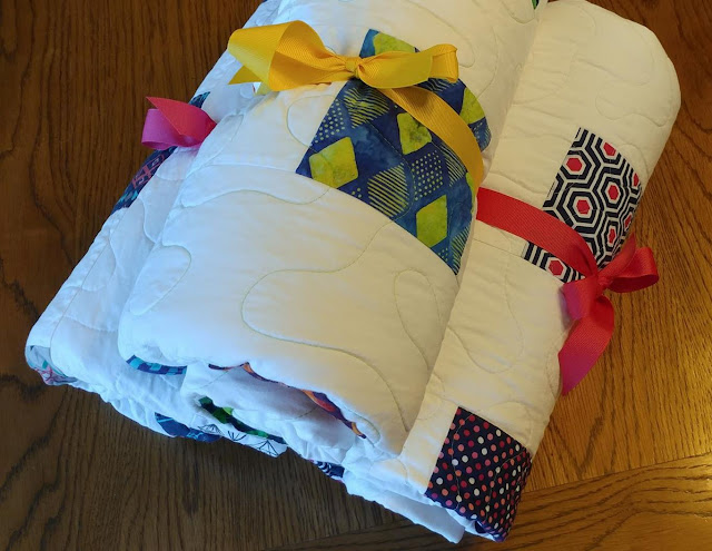 Three charity quilts for foster teens