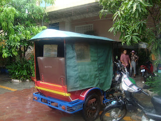Tuk - tuk in the rain in Siem Reap - Cambodia