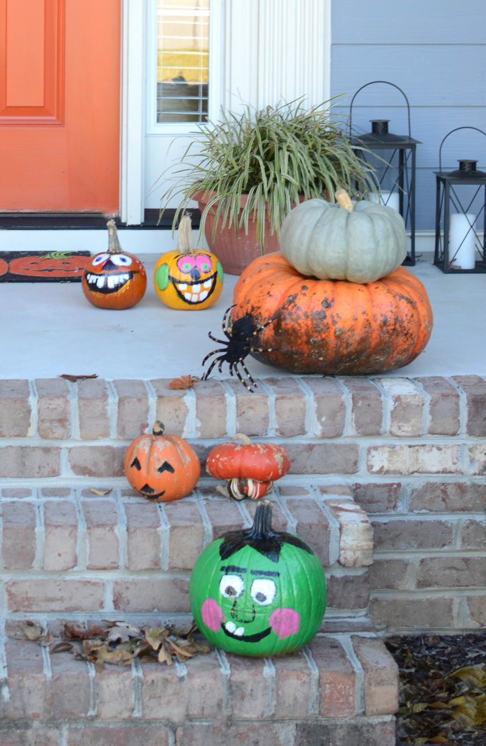 Monster painted pumpkins, a diy monster door make this front stoop Halloween ready.