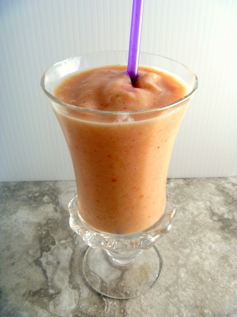 Take yourself virtually to the tropics with my Tropical Sunset Smoothie.  It's a perfectly refreshing drink made for hot summers. - Slice of Southern