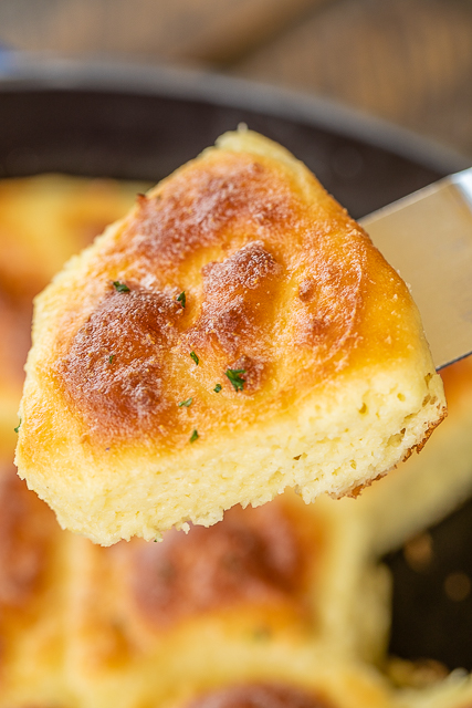 Cheesy Keto Biscuits - delicious! Even if you aren't doing the Keto diet, you will love these biscuits! We had these at a friends house, and my husband couldn't stop eating them!! SO good! LOADED with cheese! Cream cheese, mozzarella cheese, eggs, baking powder, almond flour and melted butter. Can make individual biscuits or one large loaf. I like to brush the baked biscuits with melted butter and garlic powder. #keto #bread #lowcarb