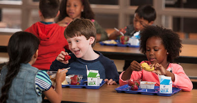 Children eating school lunch