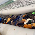 Photo: Rubber boat packed with bodies of African migrants washed up on shore in Libya